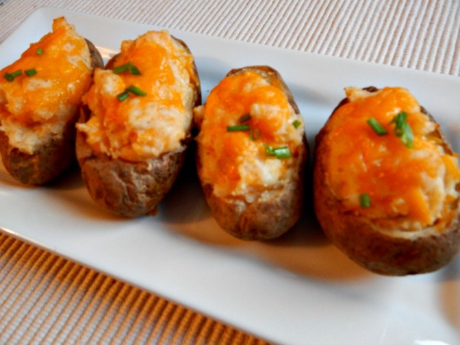 Twice Baked Potatoes from the Freezer - This is what happens when you ask your child to sprinkle a little extra cheese on them! :) They were good, though!