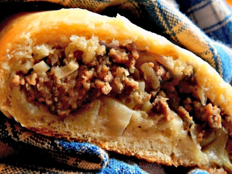 The Runza: Probably the original Hot Pocket! A sweet home-made dough stuffed with a ground beef/cabbage mixture. This recipe walks you through all the steps