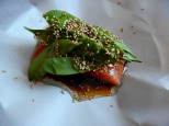 The Salmon is ready to be folded - notice it is resting on a plate...