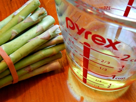 Break off a couple asparagus spears by bending - then slice the rest off at the same length. Use Vegetable waste for Smoothies!
