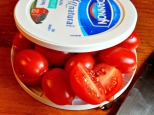 Slice round objects between two lids! Run knife horizontally thru center..