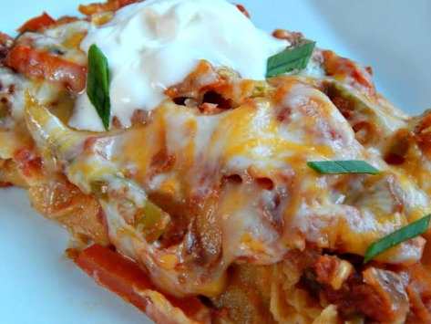 Three Cheese Enchiladas - My son prefers his with even MORE cheese, the oooier the better for him!