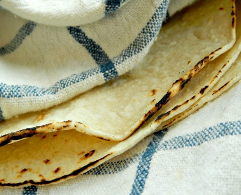 Tortillas, toasted on a burner or grill are so good with this dish. Keep warm in a clean towel.