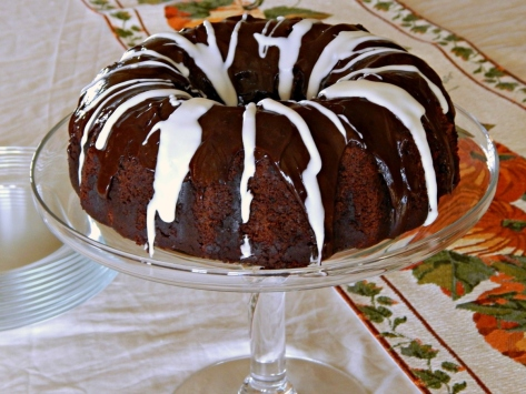 Chocolate Banana Bundt Cake with a Rum Spiked Cream Cheese, Chocolate Chip Tunnel, Chocolate Ganache & Vanilla Rum Glazes