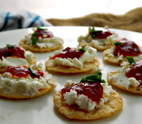 Tomato Jam on crackers with goat cheese