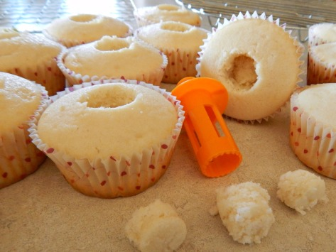 Remove a portion of the cupcake from the center. I used this small citrus reamer, but there are specialized tools, or use a small spoon or melon baller. You'll put a little piece of the removed portion over the jam.